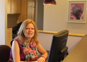 Photo of Cassie sitting at Reception Desk at Women's Healthwise in Longmont